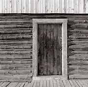 BW01878-00...WYOMING - Door along the Morman Row in Grand Teton National Park. This is an Ilford Delta 100 4x5 film image. Exposure 8 sec. f64 with a #8 yellow filter.