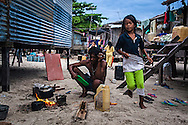 A Bajau man boiling water for tea