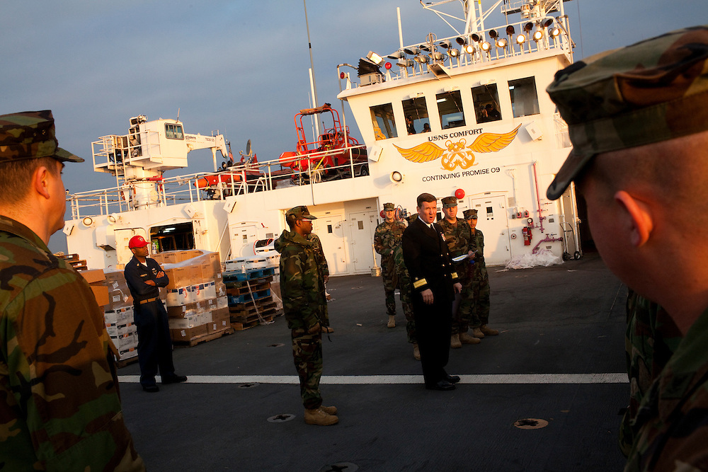 Sailors deployed from Portsmouth, Virginia, receive a pep talk from Admiral Somebody on board the USNS Comfort, a naval hospital ship, before it gets under way to Haiti to assist earthquake victims on Saturday, January 16, 2010 in Baltimore, MD.