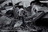 Gaza City: Palestinians walks on rubbles of a house, after was bombed by Israeli Air Force. November 17, 2012. ALESSIO ROMENZI