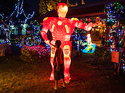 "28 JANUARY 2017 - SAMUT PRAKAN, SAMUT PRAKAN, THAILAND: A boy looks at a lantern in the form of science fiction character ""Ultra Man"" at the Chinese New Year Lantern Festival at the Tham Katanyu Foundation shrine in Samut Prakan, a suburb about 15 miles from Bangkok. More than 5,000 handmade lanterns imported from Taiwan are hung on the grounds of the shrine. Some of the lanterns are traditional Chinese lanterns, others are in the shapes of people or deities. There is also traditional Chinese entertainment, likes lion dances, at the festival.     PHOTO BY JACK KURTZ"