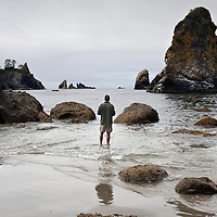 WA09211-00...WASHINGTON - Jim Johansen at Point of the Arches on Shi Shi Beach in Olympic National Park. (MR# J5)