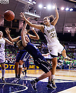 SOUTH BEND, IN - MARCH 04: As Breanna Stewart #30 of the Connecticut Huskies fouls Kayla McBride #21 of the Notre Dame Fighting Irish loses the handle on the ball at Purcel Pavilion on March 4, 2013 in South Bend, Indiana. Notre Dame defeated Connecticut 96-87 in triple overtime to win the Big East regular season title. (Photo by Michael Hickey/Getty Images) *** Local Caption *** Breanna Stewart; Kayla McBride
