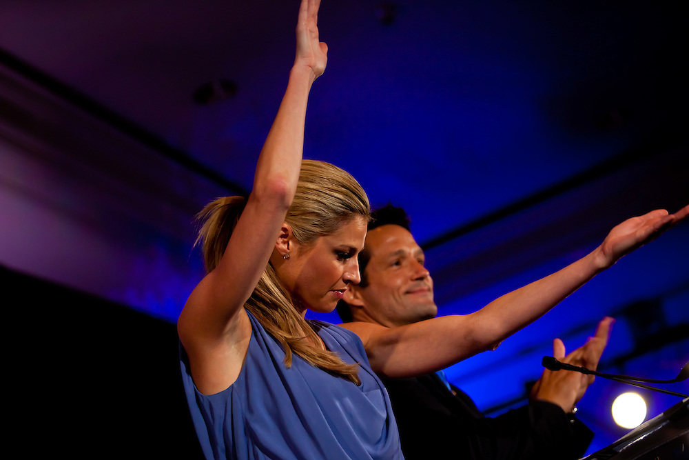 SARASOTA, FL -- May 20, 2011 -- ESPN sportscaster Erin Andrews does the Gator Chomp with Cougar Town star Josh Hopkins as she introduces coach Billy Donovan during the 6th Annual Dick Vitale Gala at the Ritz-Carlton Sarasota on May 20, 2011.  Money raised goes to the V Foundation for cancer research.   (PHOTO / CHIP LITHERLAND)