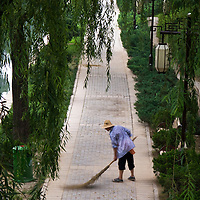 Early morning sweeping at the Yuan Dynasty Relics Park outside the Olympic center, Beijing, China