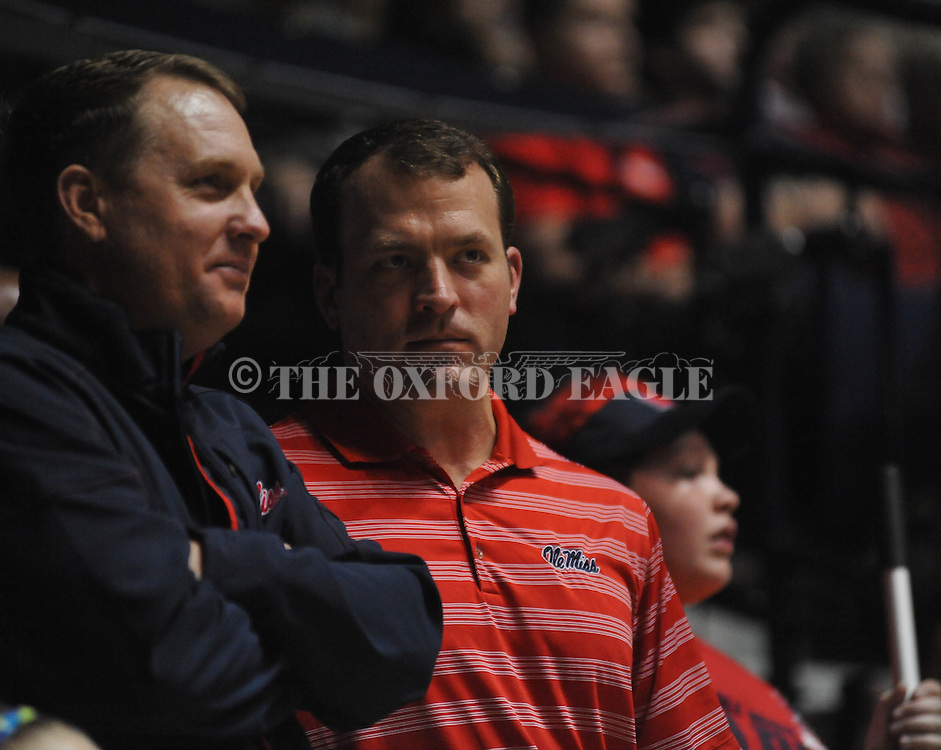 "Ole Miss head football coach Hugh Freeze (left) and athletic director Ross Bjork vs. Missouri at the C.M. ""Tad"" Smith Coliseum on Saturday, January 12, 2013. Ole Miss defeated #10 ranked Missouri 64-49."