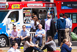Finnsbury Square, London, June 18th 2015 City workers enjoy the sunshine in Finsbury Square, buying a lunchtime ice cream as Britain's summer takes hold.