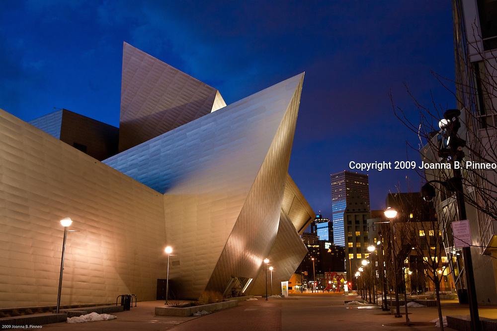 Denver Art Museum (www.denverartmuseum.org) opened a bold new wing designed by Daniel Libeskind. Exterior twilight - the Hamilton Building