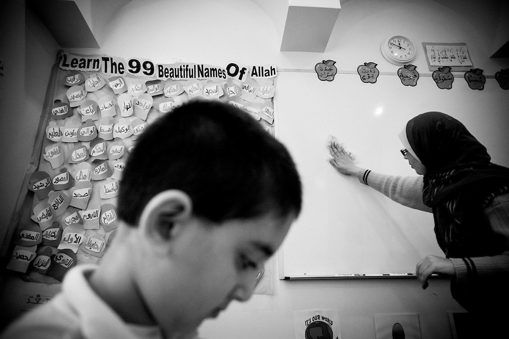 A boy learns Arabic and Quaran in English at Malik Academy in the elementary school at ISBCC.