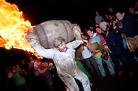 """BARREL MAN WITH FLAMING BARREL"".TAR BARRELS OF OTTERY ST MARY EAST DEVON.HELD NOVEMBER THE 5TH...BY RUPERT RIVETT ©2003.07771928201.(01273)695107"