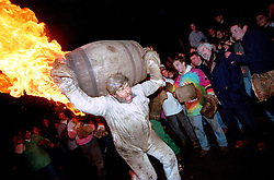 """BARREL MAN WITH FLAMING BARREL"".TAR BARRELS OF OTTERY ST MARY EAST DEVON.HELD NOVEMBER THE 5TH...BY RUPERT RIVETT ©2003.07771928201.(01273)695107"