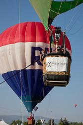 """Great Reno Balloon Race 8"" - Photographs of kids taking a tethered hot air balloon ride during the 2011 Great Reno Balloon Race."