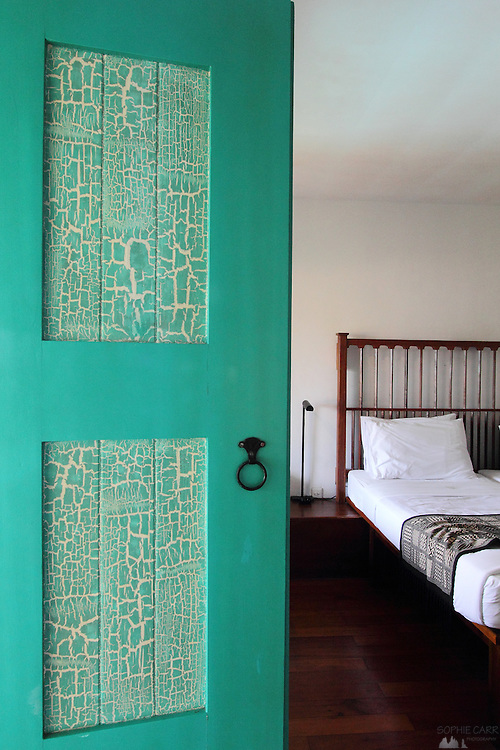 A door and view of the bed in a hotel room at the Jetwing Lighthouse, just outside Galle, in southern Sri Lanka