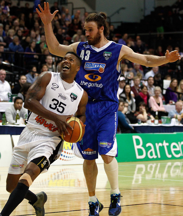 Wellington Saints' forward Casey Frank, right, stands over Hawkes Bay Hawks' forward Galen Young in the National Basketball League game, TSB Bank Arena, Wellington, New Zealand, Saturday, May 05, 2012. Credit: SNPA/Dean Pemberton.