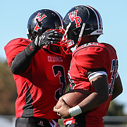 William Penn Running back Christopher Davis (3) and Running back Joe Greenwood (32) celebrate in the end zone in the second half after Greenwood score a running touchdown Saturday, Oct. 10, 2015 at Bill Cole Stadium in New Castle, DE.