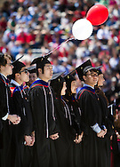 Creative cap and gown modifications were plentiful during the University of Wisconsin-Madison commencement ceremony at Camp Randall Stadium, Saturday, May 17, 2014.