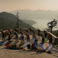 The smoke persisted through the Arc'teryx climbing Academy in Squamish, but it didn't stop this group from their yoga session at the top of the Sea to Sky Gondola.