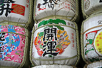 """Giant Sake Casks at Meiji Shrine - Sake is a Japanese alcoholic beverage made from rice. In Japanese, sake refers to alcoholic drinks in general. The Japanese term for this specific drink is Nihonshu, meaning """"Japanese sake.""""  Sake is also referred to in English as rice wine."""