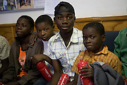 Zimbabwean children  (11-16 year old) displaced by recent violence and hunger in Zimbabwe are looked after by members of the Messina police force (SAPC). All are illegal immigrants from Zimbabwe caught 'jumping the border' but cannot be returned to Zimbabwe because no contact can be established with relatives to confirm positive identification. ..Children are kept in a 'holding facility' within the local police station compound and are provided with leisure time, an opportunity to play football in a local play area - mostly unsupervised. All return the holding facility each evening where they have a safe place to sleep and obtain a meal...Donations by a local church group and a number of local businesses have provided the children with training shoes and some clothing distributed by station Superintendent K. M. Mathiebula of Messina police station. S/Supt Mathiebula stated that there are no plans to force the children to return to Zimbabwe and they are working closely with Save the Children (UK) to provide more suitable accomodation for the children and to employ a teacher to provide some basic education during their stay in South Africa..