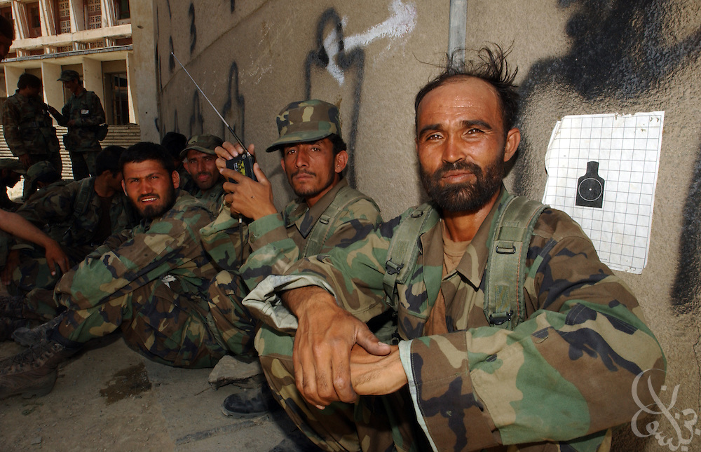 Afghan National Army (ANA) soldiers wait to train under U.S. Army Special Forces May 27, 2002 at an Afghan National Army (ANA) training facility in Kabul, Afghanistan. U.S. Special Forces units conduct ten week training courses for the Afghan Army in the hope that a better trained military will mean a more stable Afghanistan.