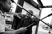 """Michael Frazier fends off the attack of another man, whom he told """"I don't like you"""" just moments before, at a downtown bus stop. The 62-year old had been waiting for a Circulator bus near Baltimore's Inner Harbor before they tried hitting each other with aluminum canes. The free bus service has been beset by issues involving intoxicated and vagrant individuals, and is considering charging to make up for a funding shortfall."""