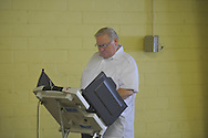 Allen Harris votes in a primary runoff election at the old National Guard Armory in Oxford, Miss. on Tuesday, August 23, 2011.
