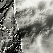 Storm clouds swirl in the lee of the West Ridge of Mont Blanc (4.807 meters), western Europe's highest peak