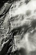 Storm clouds swirl in the lee of the West Ridge of Mont Blanc (4.807 meters), western Europe's highest peak