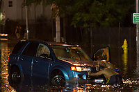 Good Samaritans help push a car out of flood waters on Washington Street in Worcester, Massachusetts on October 21, 2016.  Flash flooding in the area left many motorists stranded and closed down parts of route I-290.  Copyright Matthew Healey<br /> <br /> (FREELANCE SUBMISSION)