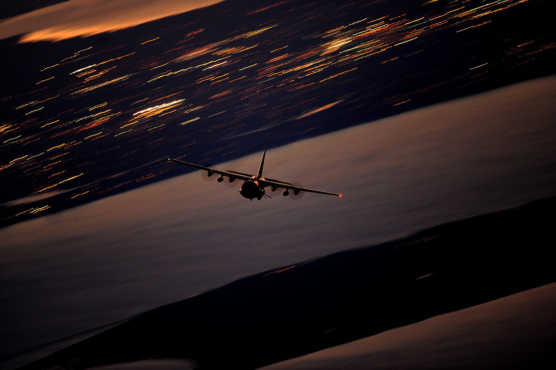 """An AC-130U Gunship from the 4th Special Operations Squadron flies a local training mission on January 27, 2011, at Hurlburt Field, Florida. The AC-130U """"Spooky"""" gunship is the primary weapon of Air Force Special Operations Command. Its primary missions are close air support, air interdiction and armed reconnaissance. The U model is an upgraded version of the H and is equipped with side firing, trainable 25mm, 40mm, and 105mm guns. — © Master Sgt. Jeremy T. Lock/"""