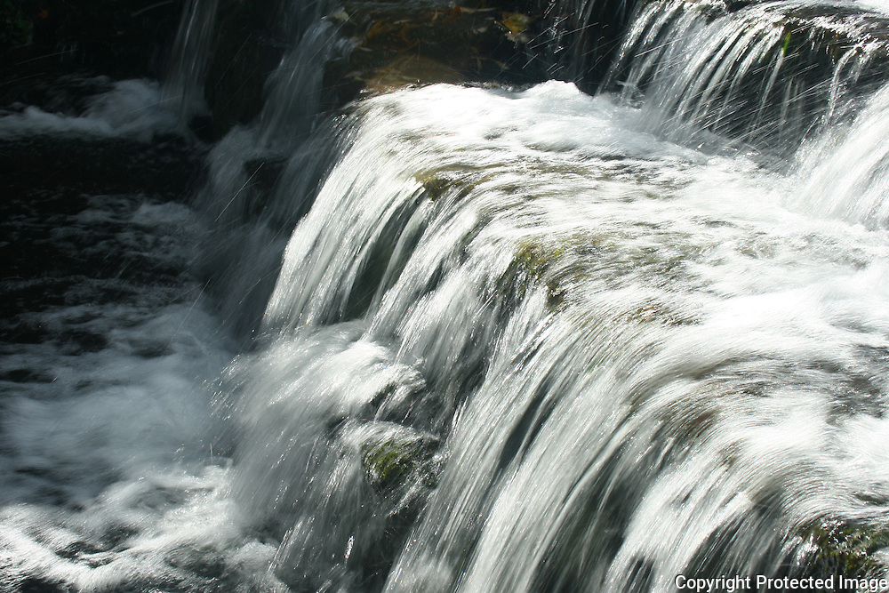 A rushing cascade in a mountain stream in Owasco Inlet, Upstate New York