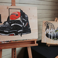 Original art by artist Kyle Page is on display during Sneaker Jam Sunday July 20, 2014 at Carolina Club 1880 in Wilmington, N.C. The event offered sneaker collectors the opportunity to purchase and trade new and rare shoes. (Jason A. Frizzelle)