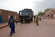 Mohamed aka Boss in front of his ghetto. A truck has just arrived at the ghetto. Young African migrants will travel through the Ténéré desert to Dirkou, Niger, not far from the Lybian border.