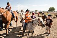 Crow Fair Rodeo, Crow Indian Reservation, Montana, kids, horses