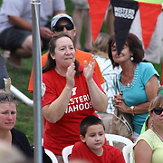 Family and friends cheer from the stands during the Summer Swim league championships finials Saturday, July. 17, 2015 at Western YMCA in Wilmington, DEL