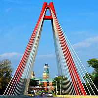Robert N. Stewart Second Street Bridge in Columbus, Indiana<br /> This cable-stayed Second Street Bridge is a beautiful gateway to Columbus, Indiana. It is also a perfect picture frame for the Bartholomew County Courthouse in the background. In 2013, the span was renamed the Robert N. Stewart bridge in honor of a former city mayor. Columbus is often called the &ldquo;Athens of the Prairie.&rdquo; The city is a charming blend of historic buildings, modern architecture, outdoor art and lush parks. For a very special treat, visit Zaharakos Ice Cream Parlor and marvel at all of the old soda fountains while slurping on a chocolate malt with whip cream and a cherry on top.