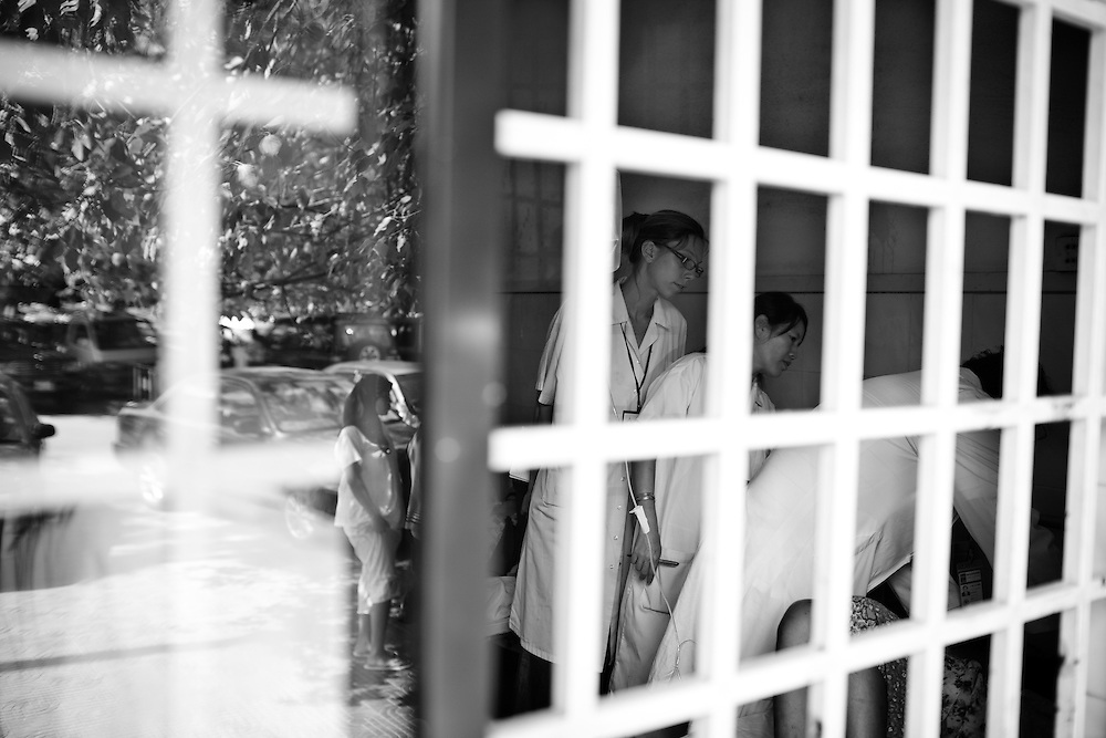 Doctors at Calmette Hospital check on victims who were injured in the stampede on November 22nd in Phnom Penh, Cambodia.