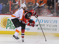 May 6, 2012; Newark, NJ, USA; Philadelphia Flyers defenseman Andreas Lilja (6) hits New Jersey Devils right wing Stephen Gionta (11) during the third period in game four of the 2012 Eastern Conference semifinals at the Prudential Center.  The Devils defeated the Flyers 4-2.