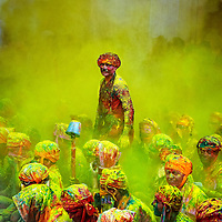 A man standing amidst the cloud of yellow color...<br /> <br /> The festival of Holi is a religious festival. People sing bhajans of Radha and Lord Krishna on this day and it marks the beginning of Spring Season in india...<br /> <br /> Taken during Holi celebration in India.