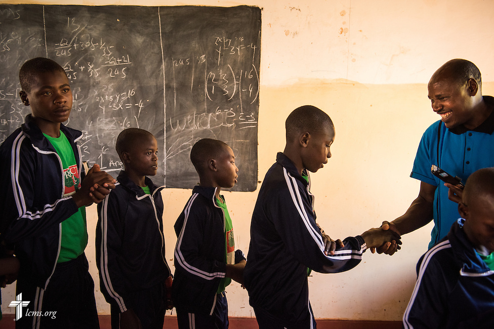 John Kissinger Nyang'au, director of Project 24, greets the young men at the Othoro ELCK (Evangelical Lutheran Church in Kenya) Project 24 boarding facility on Sunday, Oct. 18, 2015, in Kisumu, Kenya. LCMS Communications/Erik M. Lunsford
