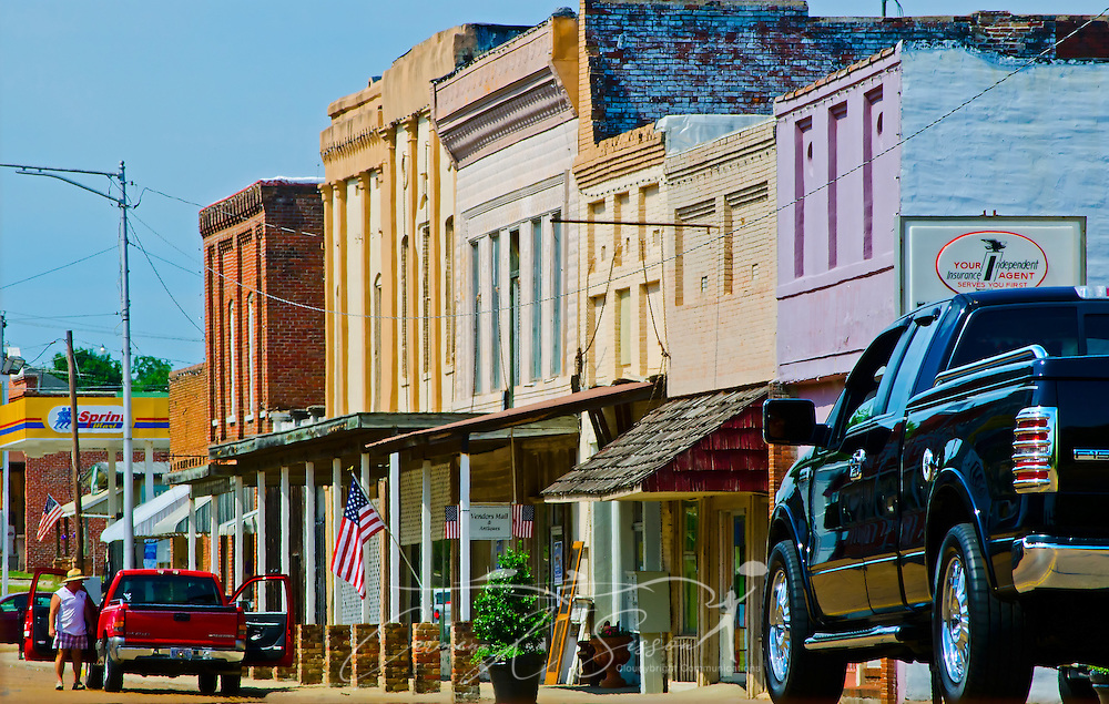 Trucks drive down the street in downtown Water Valley, Mississippi. (Photo by Carmen K. Sisson/Cloudybright)