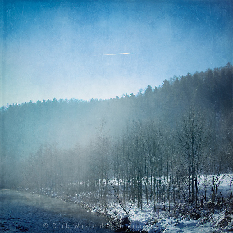 Morning fog and rising sun at river Wupper/Germany on a cold winter morning.<br />