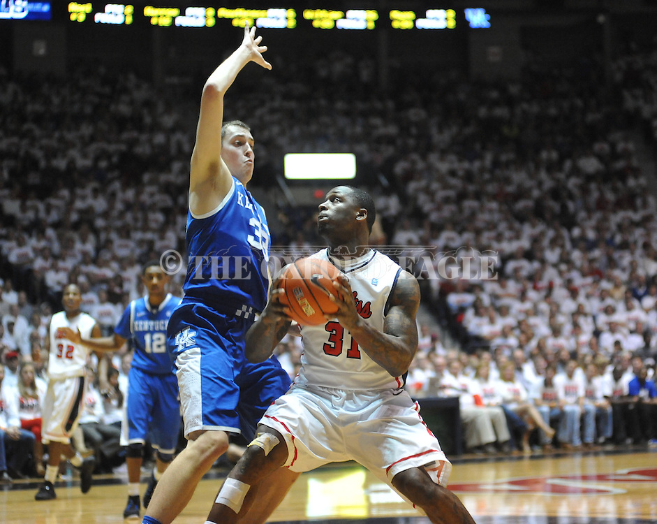 "Ole Miss' Murphy Holloway (31) vs. Kentucky's Kyle Wiltjer (33) at the C.M. ""Tad"" Smith Coliseum on Tuesday, January 29, 2013. Kentucky won 87-74. (AP Photo/Oxford Eagle, Bruce Newman).."