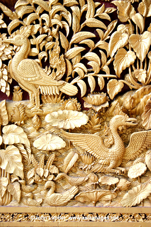 Thai Gilt Bas Relief depicting a phoenix done up in gold leaf.