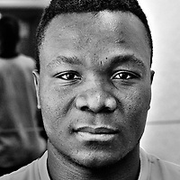 Refugee seeking asylum in Switzerland. Photographed in Geneva in the shelters in which they are being housed, for an Inside Out Project, and an exhibition. The photos, as large posters, will be posted up by the refugees themselves in the city, at Plain Palais. The 51 portraits were made in one day, in three different centres housing the more than 6000 asylum seekers in the city.