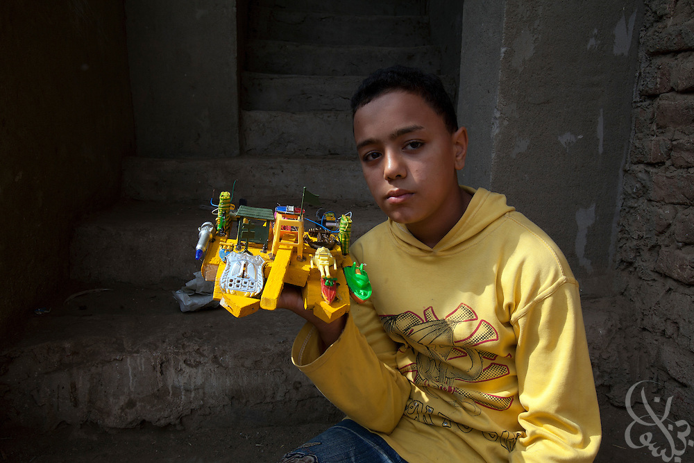 Egyptian youth Mahmoud Mohammed poses for a portrait with his toy built that he recently built from scavenged parts October 27, 2011  in the village of Warwara, outside the Delta city of Benha, and about 50 kilometers north of Cairo. (Photo by Scott Nelson)