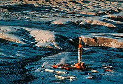 Stock photo aerial view of an frac operation at a oil rig site in the Missouri Breaks of Montana.