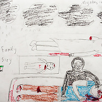 """""""Black clouds. A mother crying for her son, baby, and sister. She lost 3 family members."""" Drawing by Syrian girl, age 13. (Topic for this session: dealing with loss.) (Note: Last name removed from top-right)"""