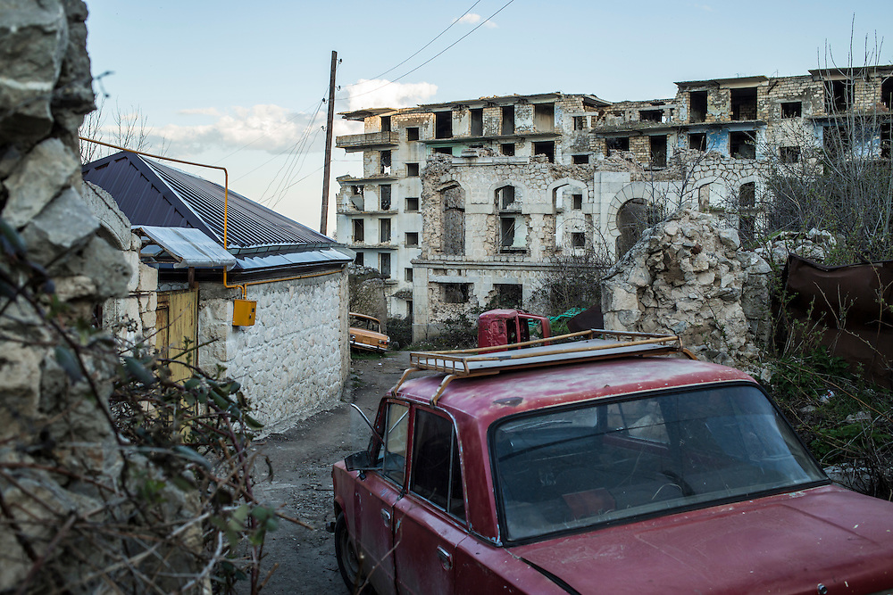 SHUSHI, NAGORNO-KARABAKH - APRIL 18: A back alley leads to a building destroyed by war more than twenty years earlier on April 18, 2015 in Shushi, Nagorno-Karabakh. Since signing a ceasefire in a war with Azerbaijan in 1994, Nagorno-Karabakh, officially part of Azerbaijan, has functioned as a self-declared independent republic and de facto part of Armenia, with hostilities along the line of contact between Nagorno-Karabakh and Azerbaijan occasionally flaring up and causing casualties. (Photo by Brendan Hoffman/Getty Images) *** Local Caption ***