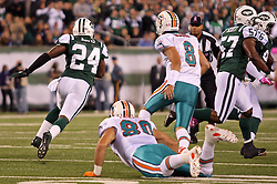 October 17, 2011; East Rutherford, NJ, USA; New York Jets cornerback Darrelle Revis (24) intercepts a pass intended for Miami Dolphins wide receiver Brandon Marshall (19) and returns it for a touchdown during the first half at the New Meadowlands Stadium.